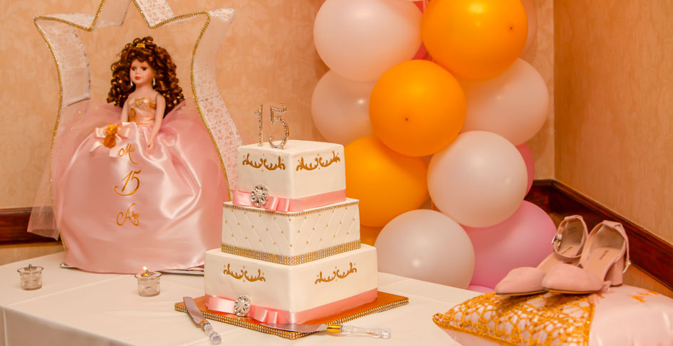 A Quinceanera cake and table decor