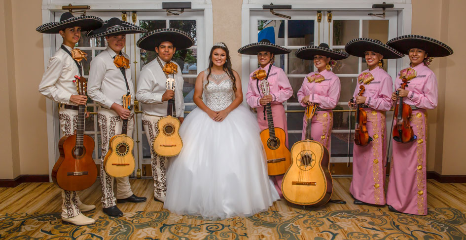 A girl with a mariachi band